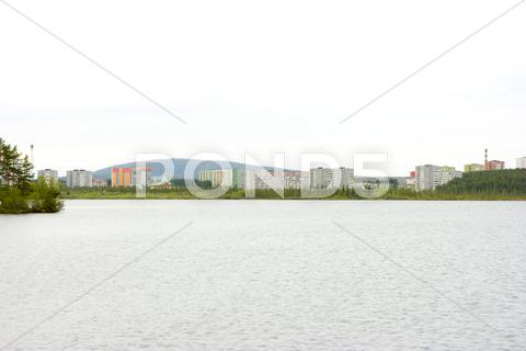 Stock photo of city at lake