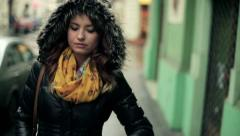 Pensive young woman walking in the city, steadicam shot HD - stock footage