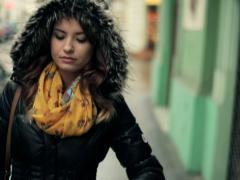 Pensive young woman walking in the city, steadicam shot NTSC - stock footage