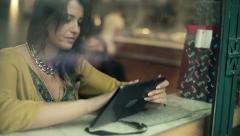 Young woman using tablet computer in cafe, steadicam shot HD - stock footage