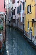 narrow canal in venice - stock photo