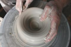 Hands on Potters Wheel - stock photo