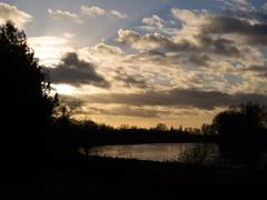 London winter sunset scene - River Thames, taken from Kew Gardens - stock photo