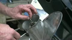 Placing Cotter pin on boat propeller Stock Footage