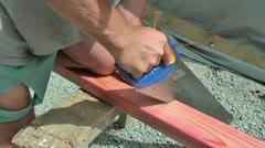 Carpenter using handsaw - stock footage