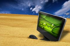 computer and mouse in the sand - stock illustration