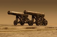 Outside scenery with nostalgic cannons Stock Photos
