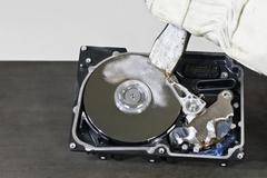 Hard disk and chisel Stock Photos
