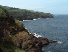cliffy coastal scenery at the azores - stock photo