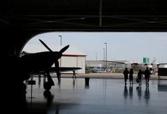 air plane hangar silhouette - stock photo