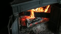 Old fire place with a warm fire. Stock Footage