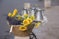 Sunflowers and pewter work for sale .. Stock Photos