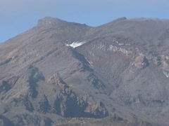 Top of mount Ruapehu zoom out highway Stock Footage