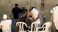 Jew Puts Tefilin at the Wetern Wall - Jerusalem 1 Stock Footage