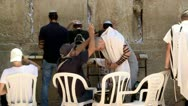 Stock Video Footage of Jew Puts Tefilin at the Wetern Wall - Jerusalem 1