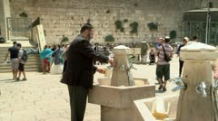 Jew Washes Hand at the Western Wall - Jerusalem Stock Footage