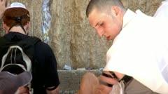 Jew Puts Tefillin at the Western Wall - Jerusalem 2 Stock Footage