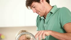 Parents washing dishes with their children Stock Footage