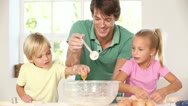 Father and children breaking eggs Stock Footage