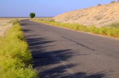 motor road across savanna - stock photo