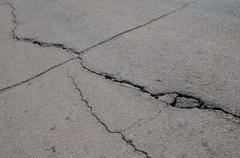 cracked asphalt - stock photo
