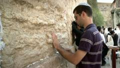 Jewish Guy Puts a Note with Pray at the Western Wall Stock Footage