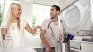 Joyful couple washing dishes together Stock Footage