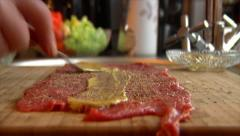 Coat mustard on beef roulade 10851 Stock Footage