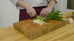 Cutting spring onions - stock footage