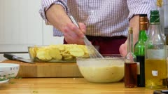 Whisking batter in a bowl - stock footage