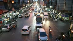 Congested roads and night traffic in Bangkok, Thailand Stock Footage