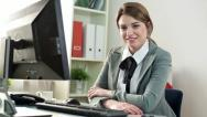 Stock Video Footage of Young, happy businesswoman in the office HD