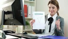 Young businesswoman showing document and thumb up sign HD Stock Footage