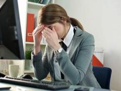 Tired businesswoman having headache in the office NTSC Stock Footage