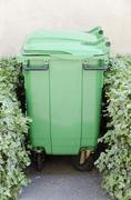 green garbage container - stock photo