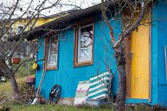 untidy small blue house - stock photo