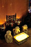 three angels around a candle - stock photo