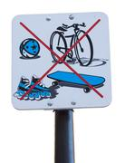 a sign prohibiting cycling, rollerbalding, skateboarding and ball playing - stock photo