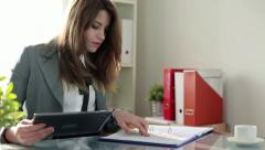 Businesswoman working with tablet computer and documents in office HD - stock footage