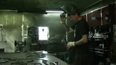 Welder Puts on Mask and Goes to Work Stock Footage