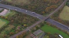 Aerial shot of roads running through the English countryside Stock Footage