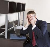 mature man feeling the pressure of the income tax season - stock photo
