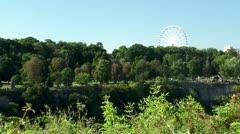 Ferris wheel in the Clifton Hill, Niagara Falls, Ontario, Canada. Stock Footage