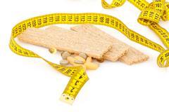Centimeter, crispbread and tablets Stock Photos