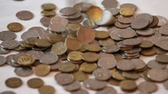 Falling coins - stock footage