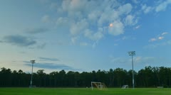 Time Lapse of Soccer Field in evening light with rolling clouds Stock Footage