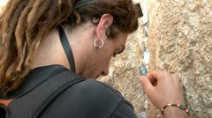 Young Modern Looking guy at the Western Wall Stock Footage
