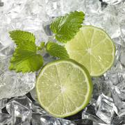 Ice with lime wedges Stock Photos
