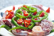 Steak with red and green peppers on a plate Stock Photos