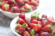 Red juicy strawberries lying on the plate Stock Photos